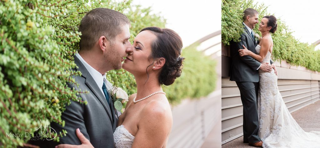 Bride and groom snuggle and kiss