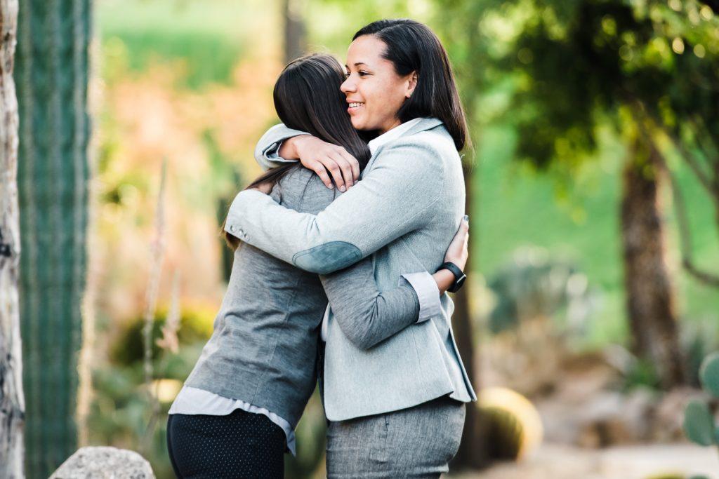 Female couple hugs