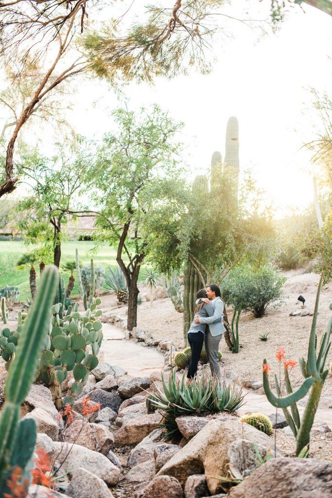 Female Couple hug in garden at sunset