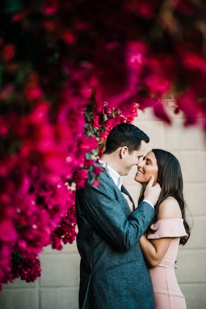 Bougainvillea surrounded engagement photo