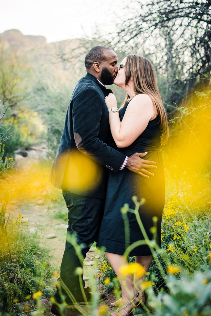 Yellow desert flowers engagement photo