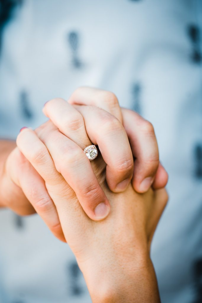 Engagement ring holding hands photo