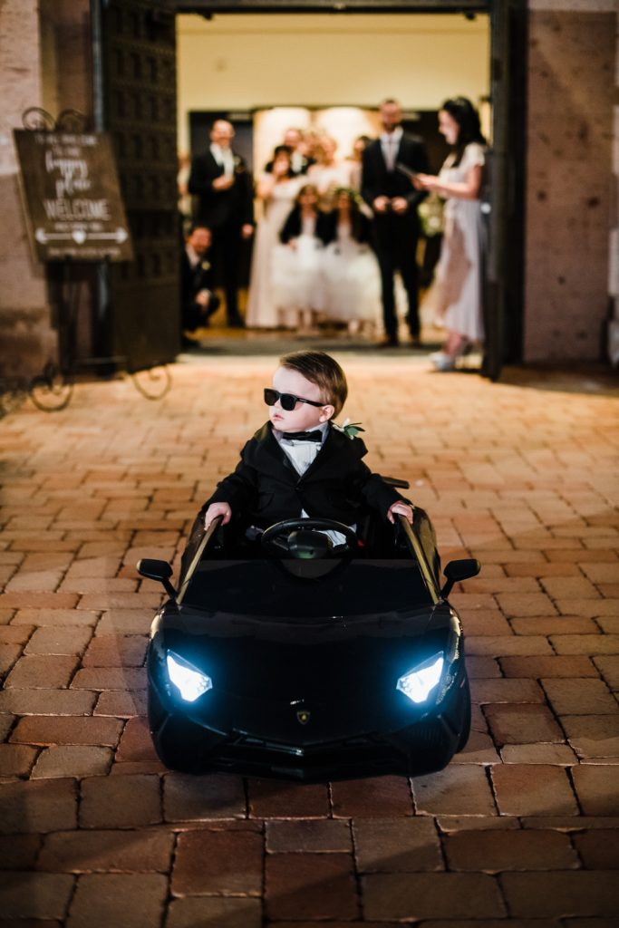 Ring bearer arrives in lamborghini