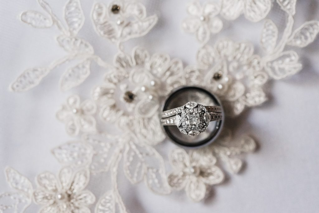Wedding rings on brides veil