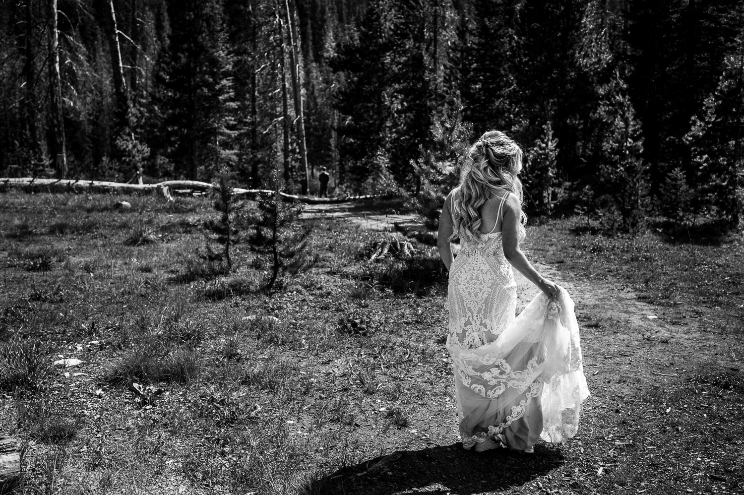 Bride walks toward Groom for first look at Piney River Ranch in Vail CO