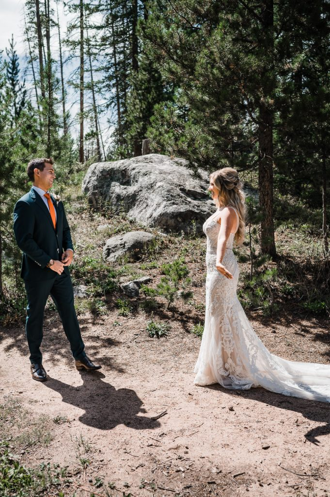 Groom sees Bride during first look at Piney River Ranch