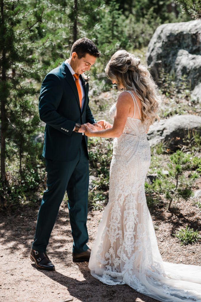 Groom sees Bride during first look at Rocky Mountain wedding