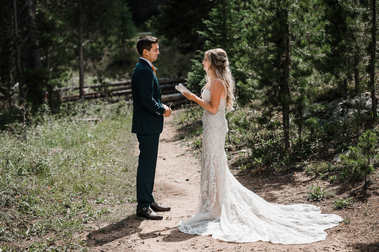 Bride and groom read private vows to each other at Piney River Ranch in Vail CO