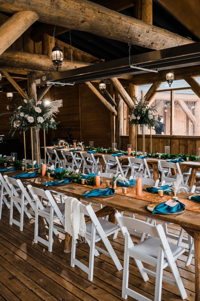 Wedding farm table setting with rust and teal colors