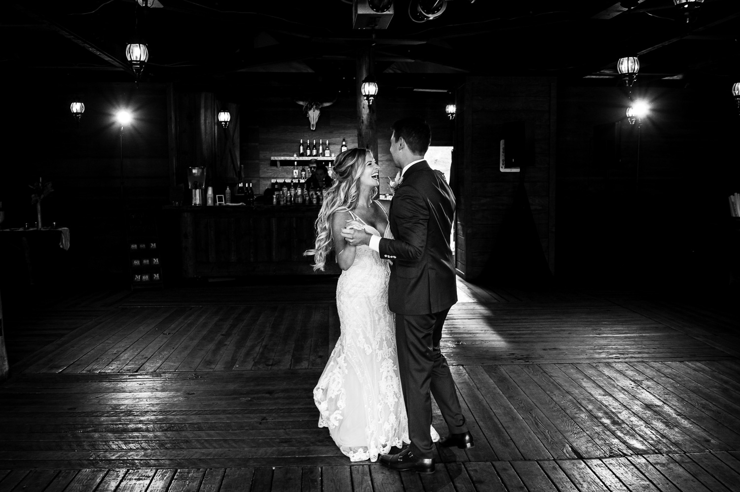 Bride laughs during first dance at Piney River Ranch wedding