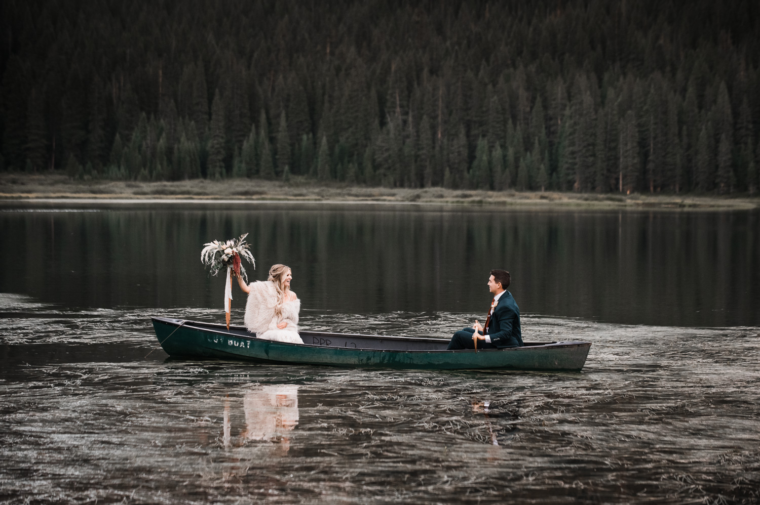 Bride and Groom in canoe on Piney Lake