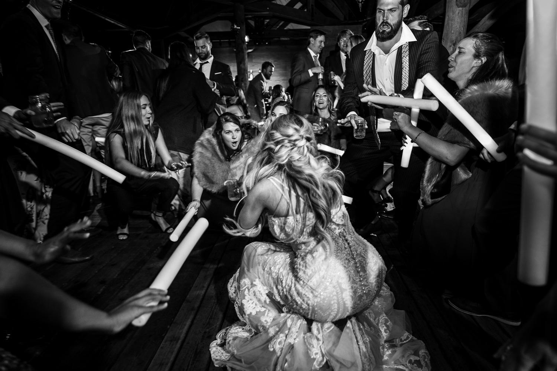 Bride gets down low on the dancefloor at wedding